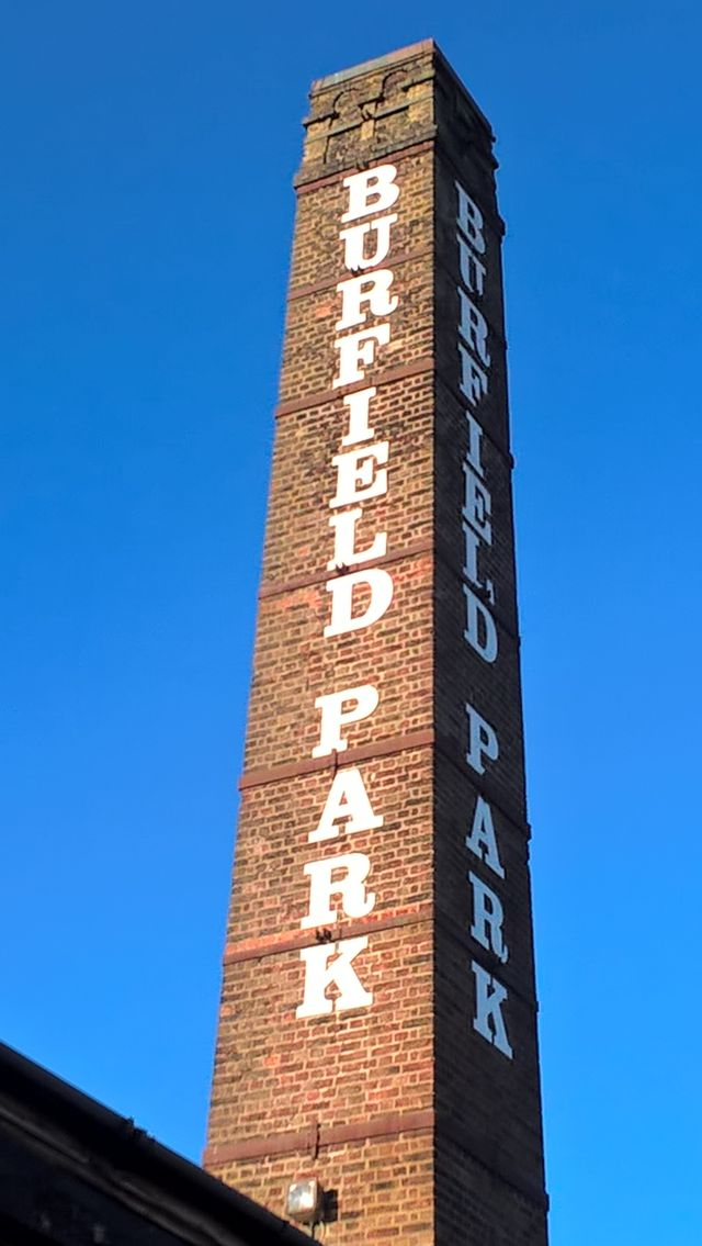 Huge chimney with Burfield Park sign on it.