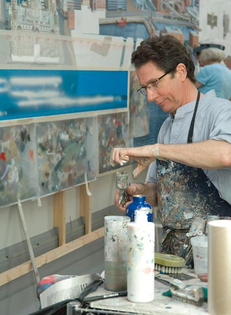 Ben spray painted the Liverpool Cityscape before hand-finishing with small sable brushes. Photo © Simon Webb.