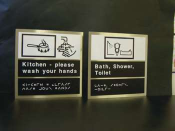 Makaton, tactile and moon signage shown in 2 signs.