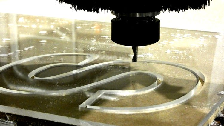 Acrylic letter 'S' being cut on a CNC Router