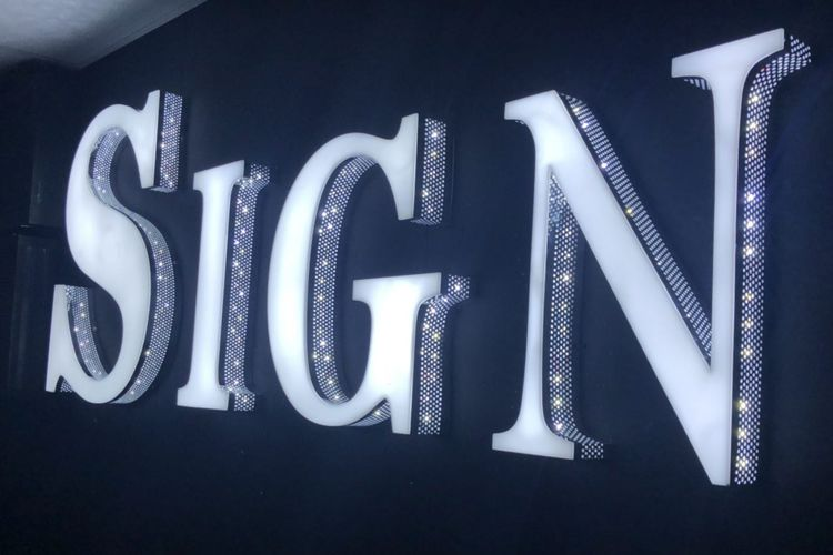 The word 'SIGN' made with built-up-letters