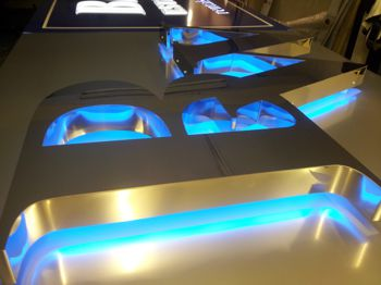 Mirror polished stainless steel built up letters with Halo effect illumination using blue LEDs.