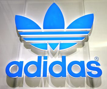 A finished addidas sign with vinyl applied to the letters