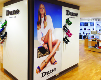 Inside a shoe shop showing large format prints on digifilm media on the wall.