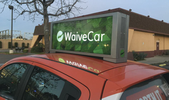 sign on top of a car that says waive car