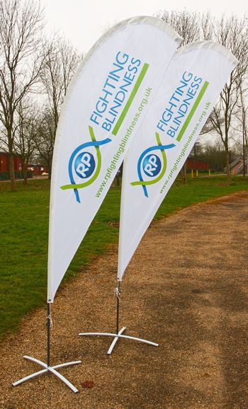 Promotional teardrop flags standing on a pathway