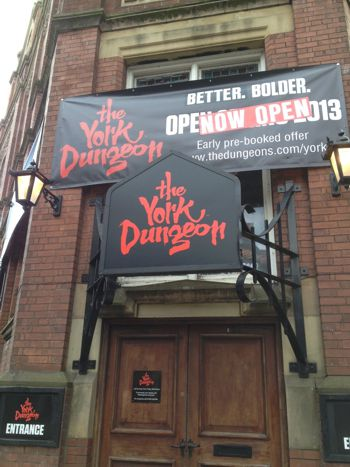 Promotional banner hanging outside the York Dungeons