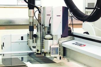 A Zund cutting machine in action