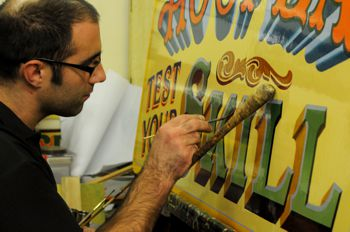 Signwriting by hand for an attraction at Carters Steam Fair