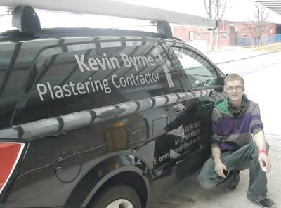 A van with lettering on the side.