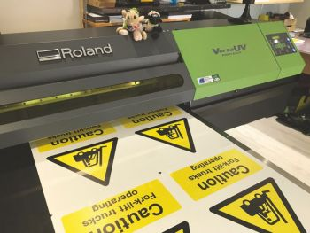 Versa UV printer printing caution signs