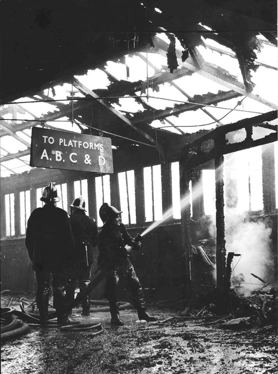 Archive image shows aftermath of fire at Waterloo station. Vitreous enamel sign was still hanging and readable from the blackened roof