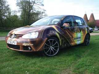 Car wrapped with vinyl graphics.