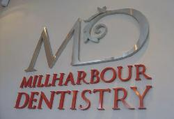 Dentistry sign with built-up letters.
