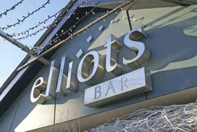 Sign saying Elliots bar using built-up letters.
