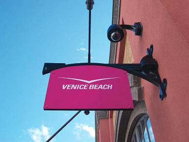 Hanging sign saying 'Venice Beach'