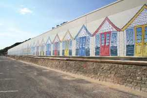 Garage that houses the land train on Boscombe seafront decorated using designs produced by eight year olds.