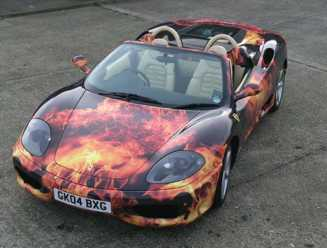 Black Porsche wrapped in vinyl flame effect graphics