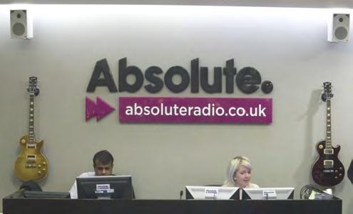 SignTrade sign for Absolute Radio, shown in reception area.