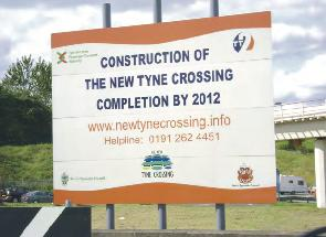 Sign saying - 'Construction of the new Tyne crossing completion by 2012'