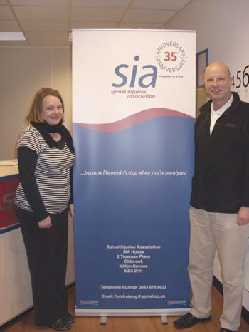 Elizabeth Wright and Alan Grimes with the SIA banner donated by Fastsigns Milton Keynes.