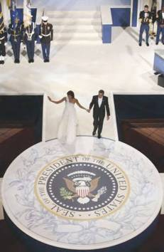 President and Mrs Obama walking on the custom-built circular stage