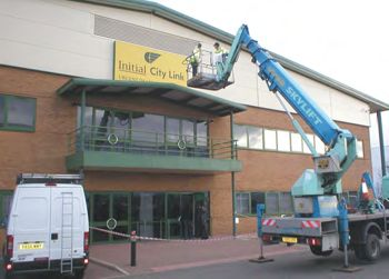 Illuminated flex face being installed by crane on lorry