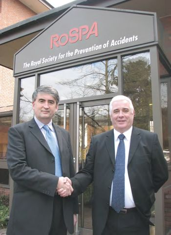 Tom Mullarkey, RoSPA Chief Executive and Bern Harrington, Sales and Marketing Director for Stocksigns, shaking hands.