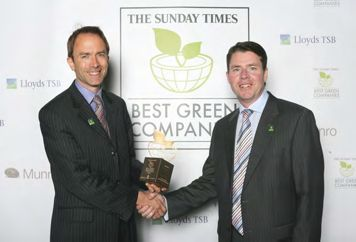Howard Browning, McNaughton's Director for Corporate Responsibility, accepting the Outstanding Environmental Performance award from Alastair McColl, Editor of The Sunday Times supplements.