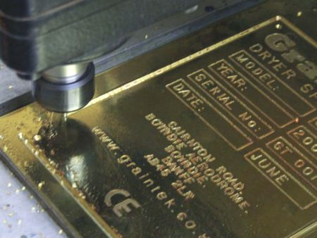 ITC cutter engraving into metal.