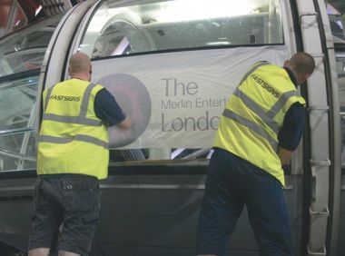 New graphics being fitted to a London Eye capsule by Fastsigns