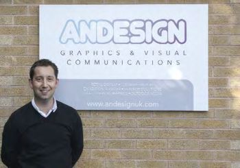 Andy Williams in front of the Andesign company sign.