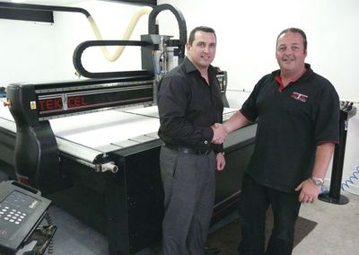 Karl Martindale, Next Generation Signs, and Julian Sage, Tekcel CNC Solutions alongside the newly installed Tekcel EXR router.