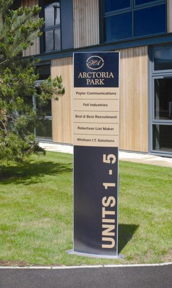 Totem monolith sign incorporating part directory, with vinyl graphics for exterior use.