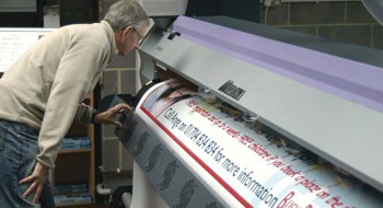 Charles Coldwell examining the output of the JV33 printer