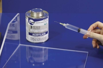 SCIGRIP's Sign and Display Adhesives applied with a syringe