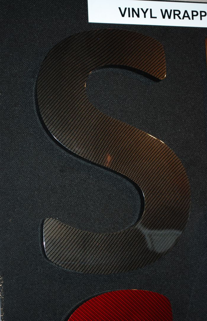 Carbon fibre effect built up letter created and wrapped by North East Signs.