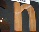 Wood effect built up letter created and vinyl wrapped by North East Signs.