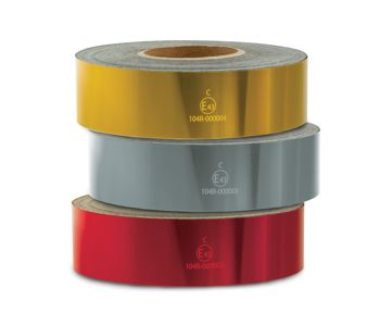 Three different coloured rolls of Nikkalite marking tape stacked on top of each other