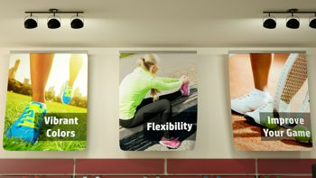promotional pictures printed on fabric displayed on wall