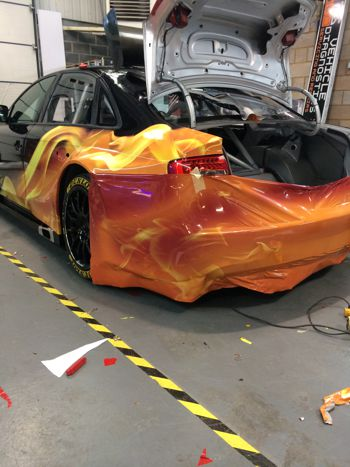 Rear of a car being wrapped.