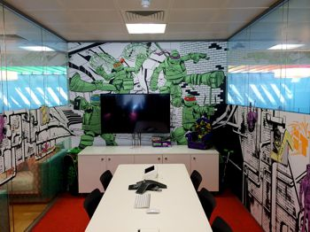 Walls of an office covered in cartoon style wall covering