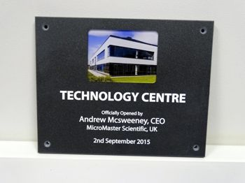 A plaque with a photo printed on it