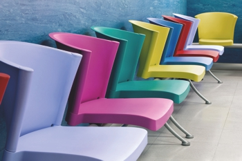 Row of coloured chairs made from CRYLUX CAST