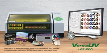 Roland printer with computer screen and accessories