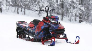 Snowmobile made with ProTec series 3960 standing in the snow