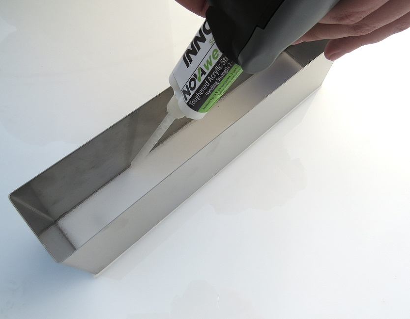 Novaweld SignFix 5 - 2 part adhesive being applied to a built up letter.