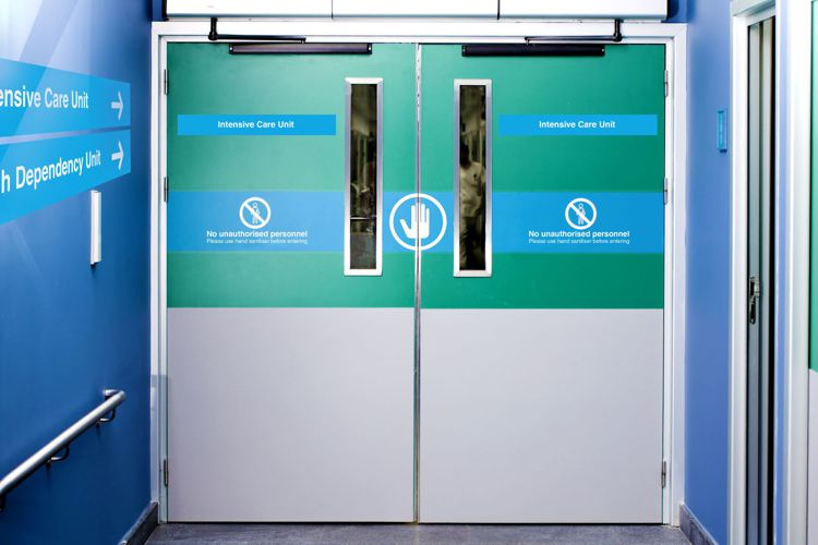 Signage in a hospital which has been laminated with a anti-bacterial film