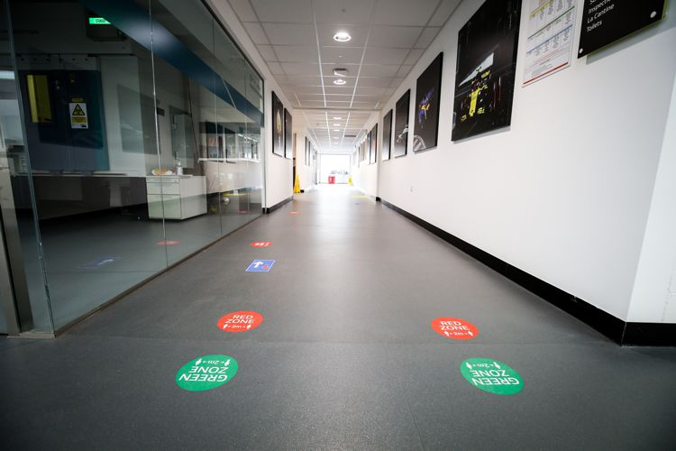Red and green zone stickers on the floor