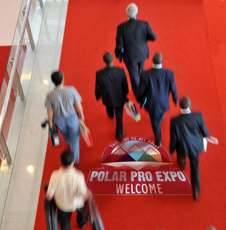 Businessmen walking inside an exhibition hall and over a floor graphic.